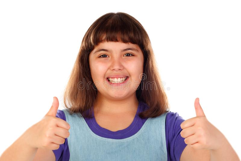 Friendly child saying Ok with her thumbs stock image