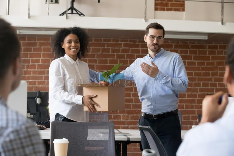 Friendly company ceo welcoming african employee in multiracial o. Friendly company ceo welcoming female african american employee introducing hired worker in stock photography
