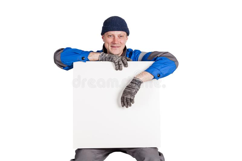 Friendly construction worker holding a blank, white sign. Isolated on white royalty free stock image