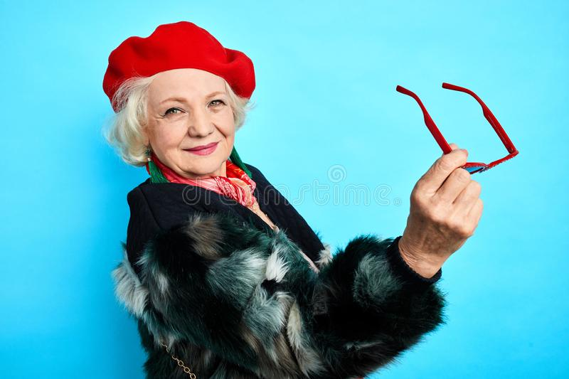 Friendly cool grandmother has bought new trendy clothes stock images