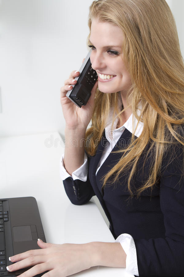 Friendly customer service person on phone royalty free stock image