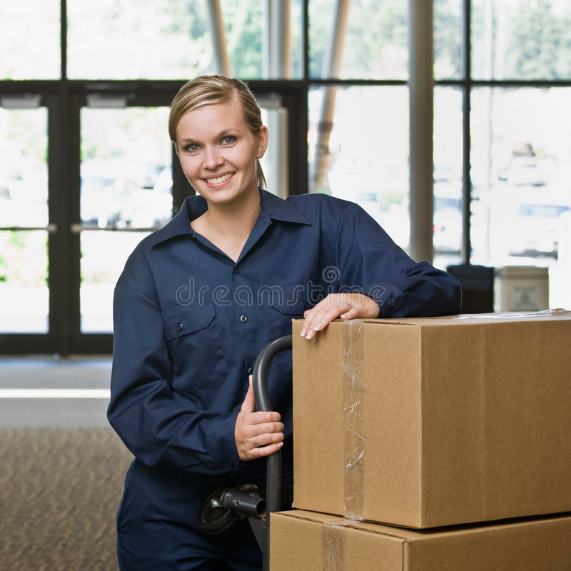 Friendly delivery woman in uniform stock photo