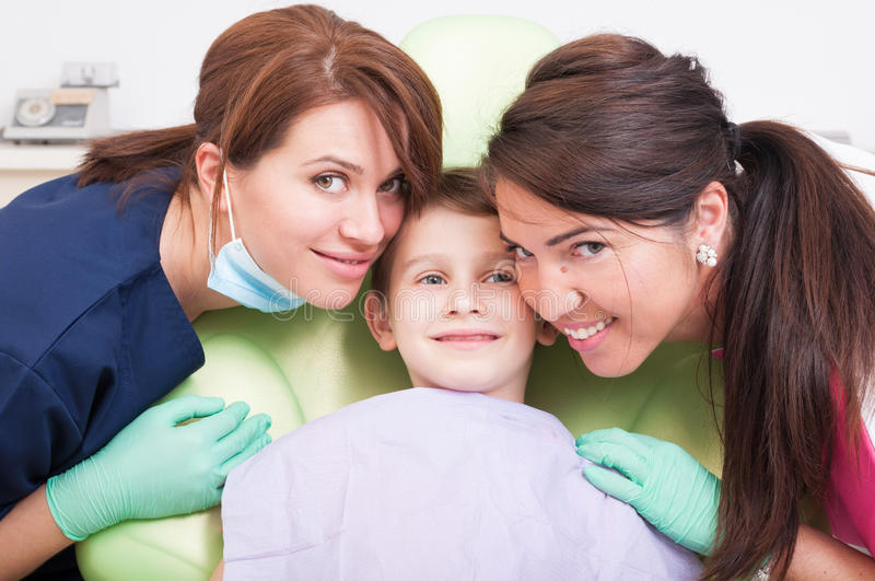 Friendly dental team and kid, boy or child patient. Smiling with confidence royalty free stock photo