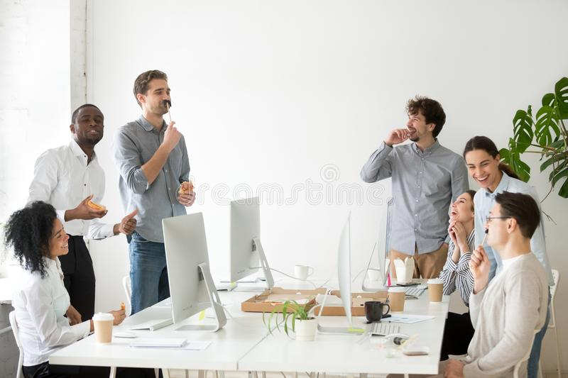 Friendly diverse team having fun during lunch break royalty free stock image