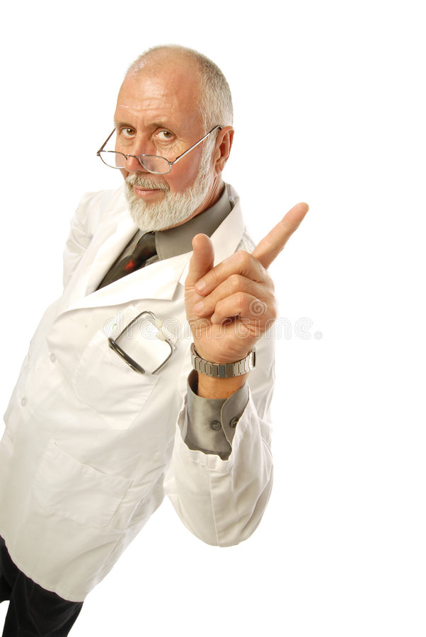 Friendly doctor. Friendly older doctor pointing at copy space to his right royalty free stock photo