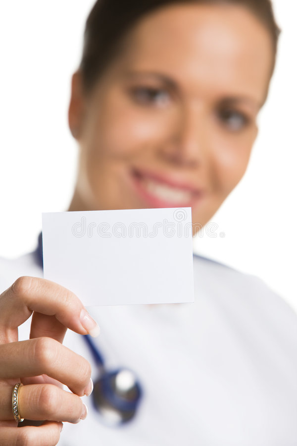 Friendly doctor with a blank white business card royalty free stock images