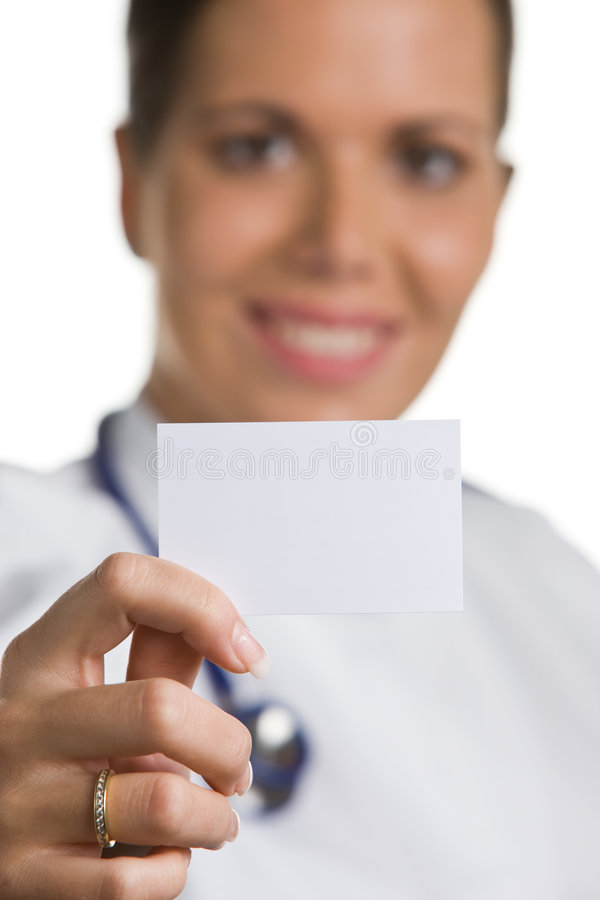Friendly doctor with a blank white business card royalty free stock image