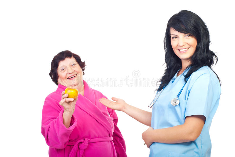 Friendly Doctor Showing To Healthy Patient Royalty Free Stock Photos