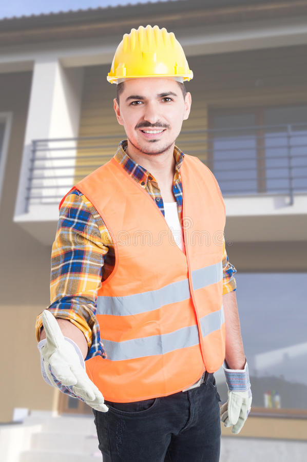 Friendly engineer or architect doing handshake gesture royalty free stock photos