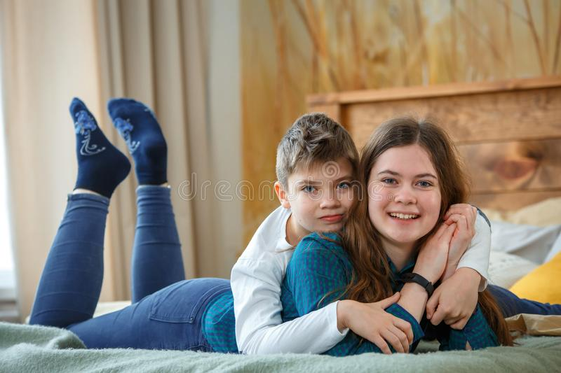 Friendly family. Brother and sister stock photos