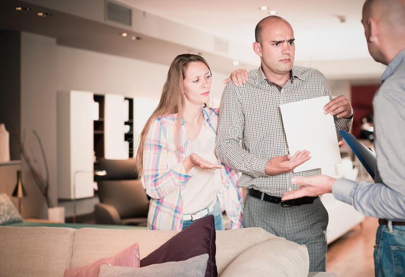 Friendly family couple dissatisfied with service stock photography