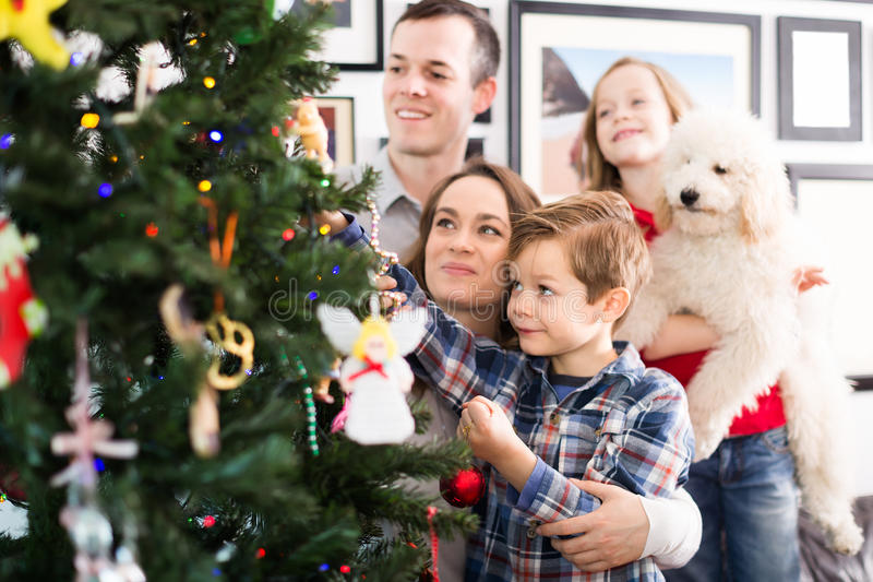 Friendly family members presenting gifts on Christmas royalty free stock photography