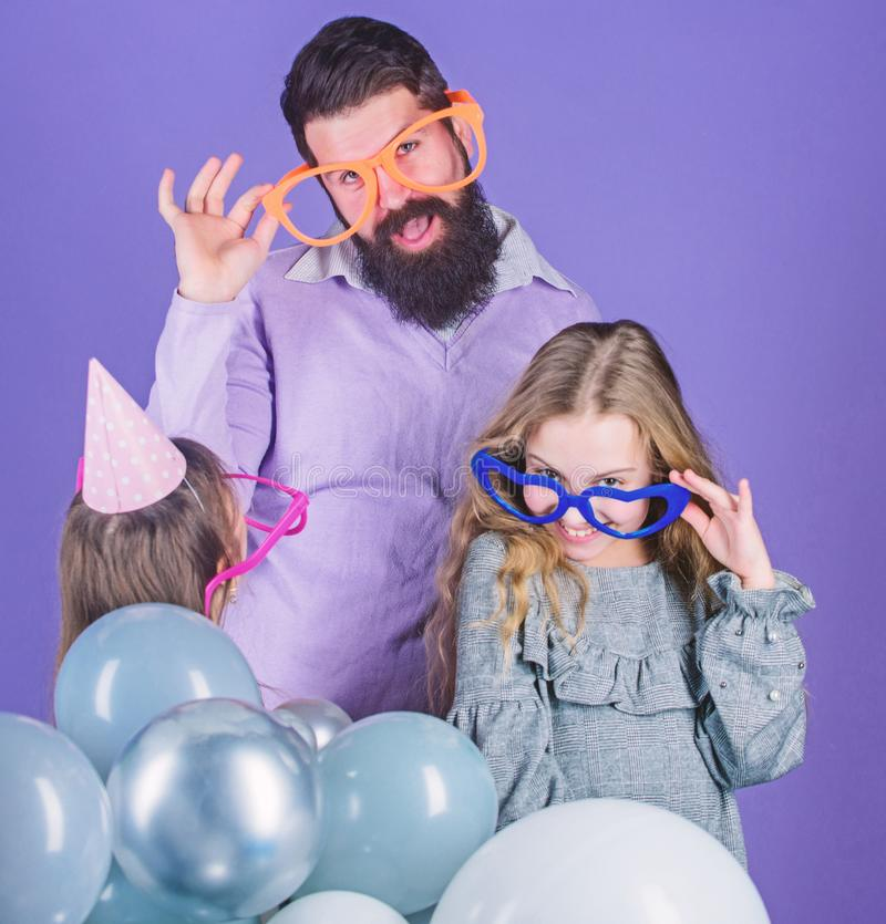 Friendly family wear funny party accessories. Fathers day. Daughters need father actively interested in life. Single. Father. Birthday party. Father with two stock photo