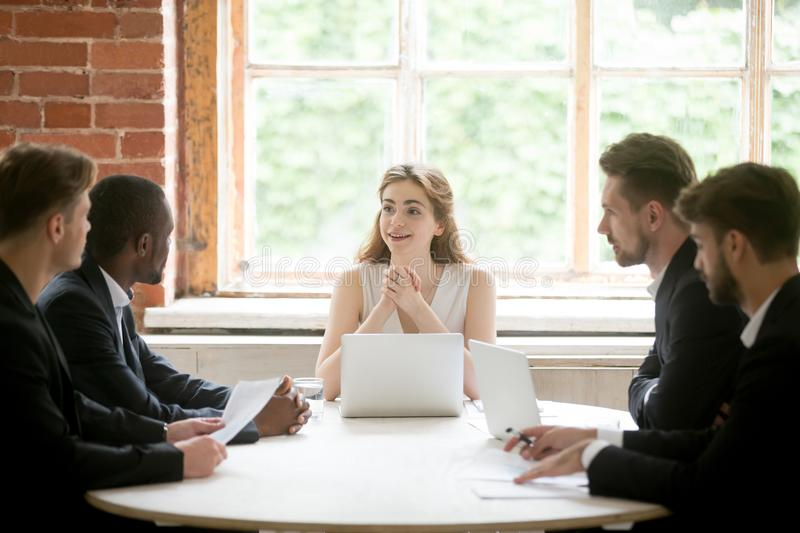 Friendly female executive holding office corporate meeting with stock images