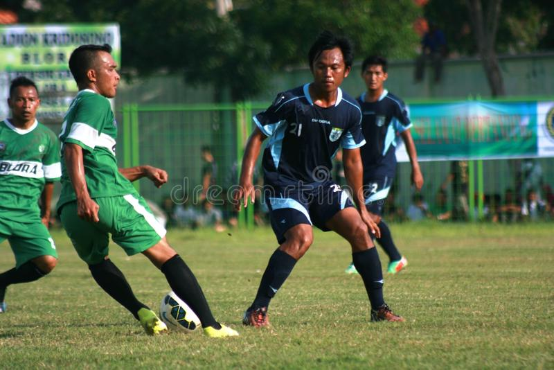 Friendly football match. A friendly football match between persikaba blora (Central Java) against Persela Lamongan (East Java) in the sports stadium in Blora stock photography