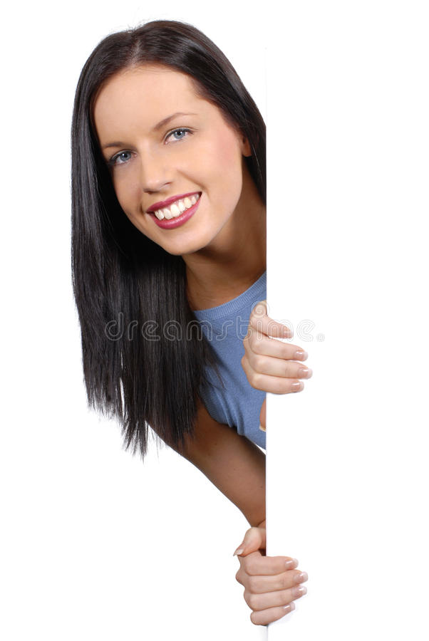 Young adult female model looking round holding white advertising board, copy space, vertical stock images