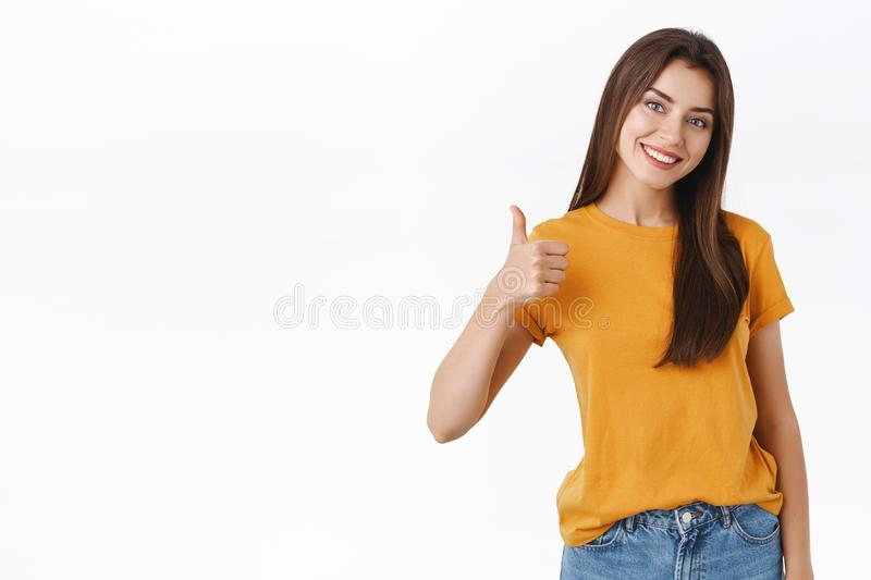 Friendly, good-looking smiling, happy young woman rate good product, give positive feedback, reply with approval royalty free stock images
