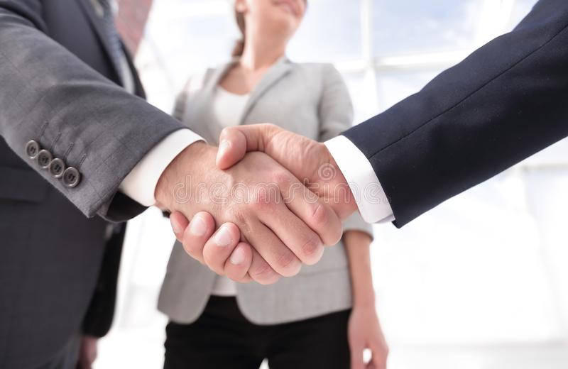 Friendly handshake of business people. stock images