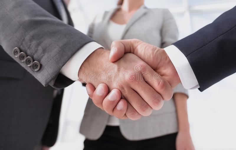 Friendly handshake of business people. Photo with copy space royalty free stock photos