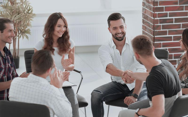 Friendly handshake colleagues when meeting stock images