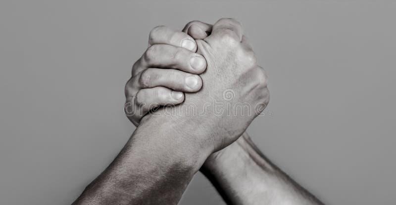 Friendly handshake, friends greeting, teamwork, friendship. Handshake, arms, friendship. Hand, rivalry, vs, challenge. Strength comparison Man hand Two men arm royalty free stock image
