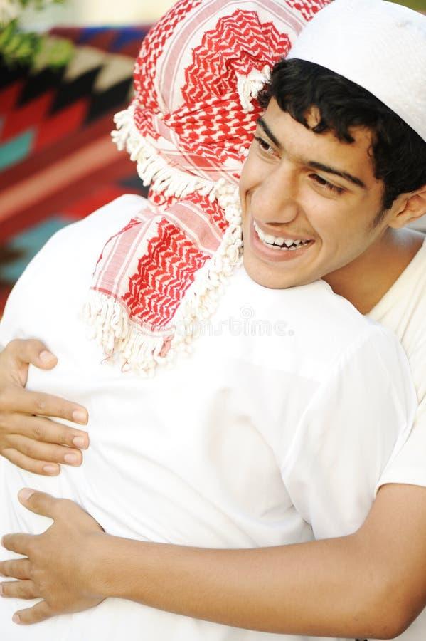 Friendly hug, two arabic stock image