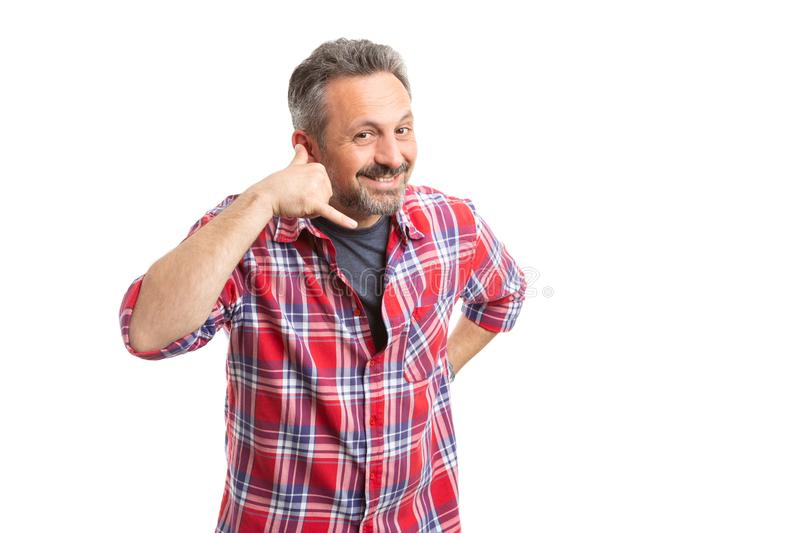 Friendly man making call me gesture stock photography