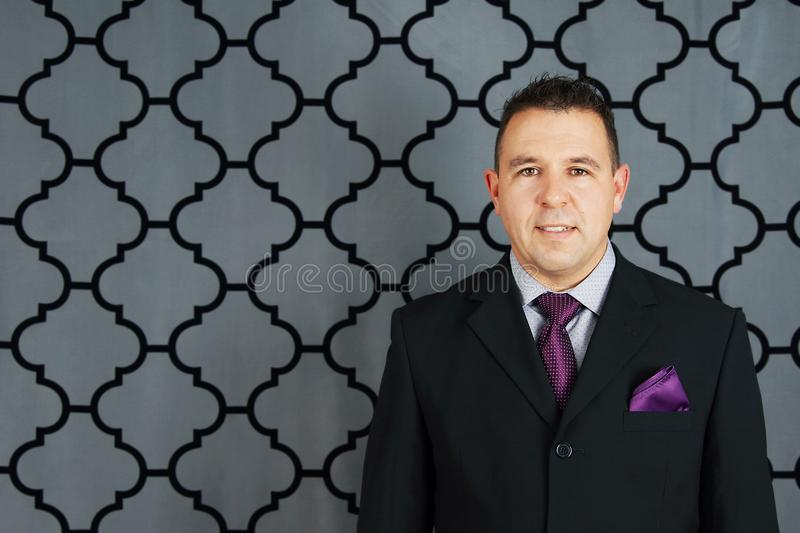 Friendly man in suit stock image