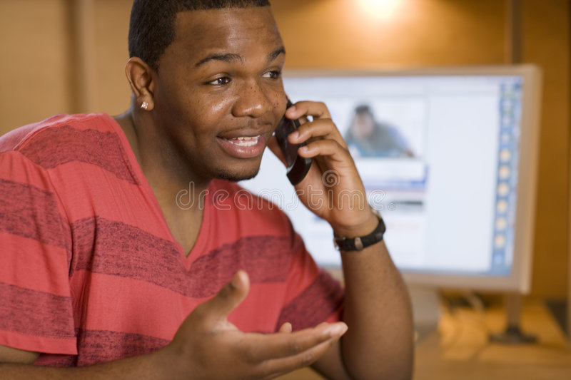 Friendly Man Talking On Cell Phone Royalty Free Stock Image