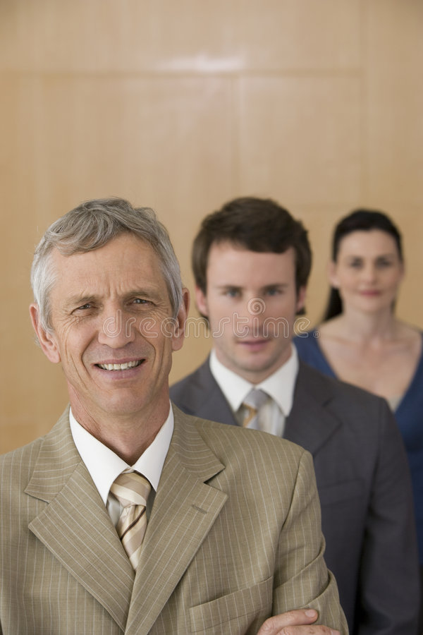 Friendly mature executive with team royalty free stock photos