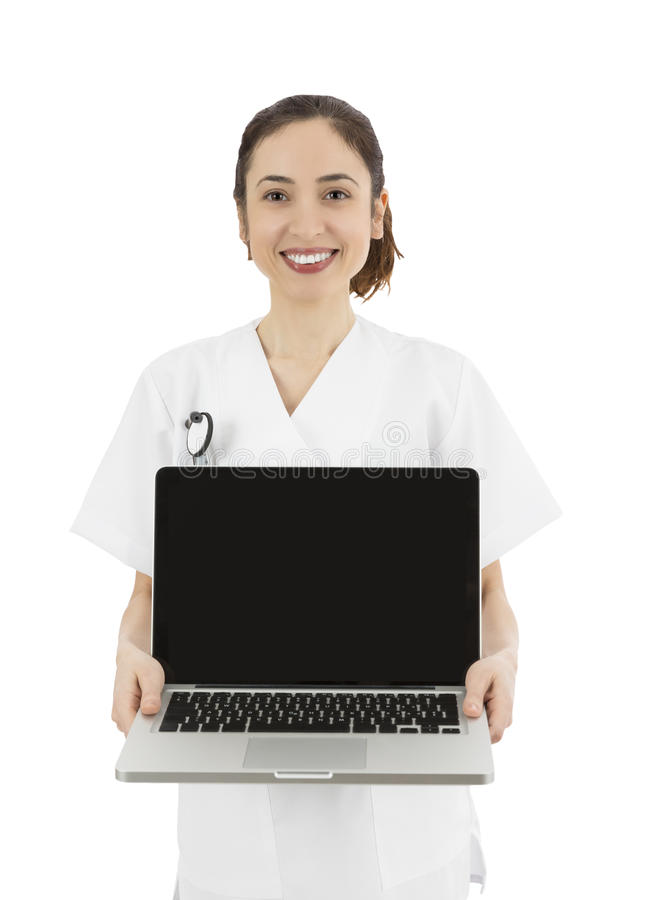 Friendly medical doctor or nurse showing a laptop with copy space. Female medical doctor showing a laptop with a blank display for copy space royalty free stock images