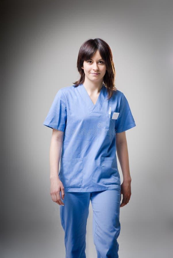 Friendly nurse walking stock photography