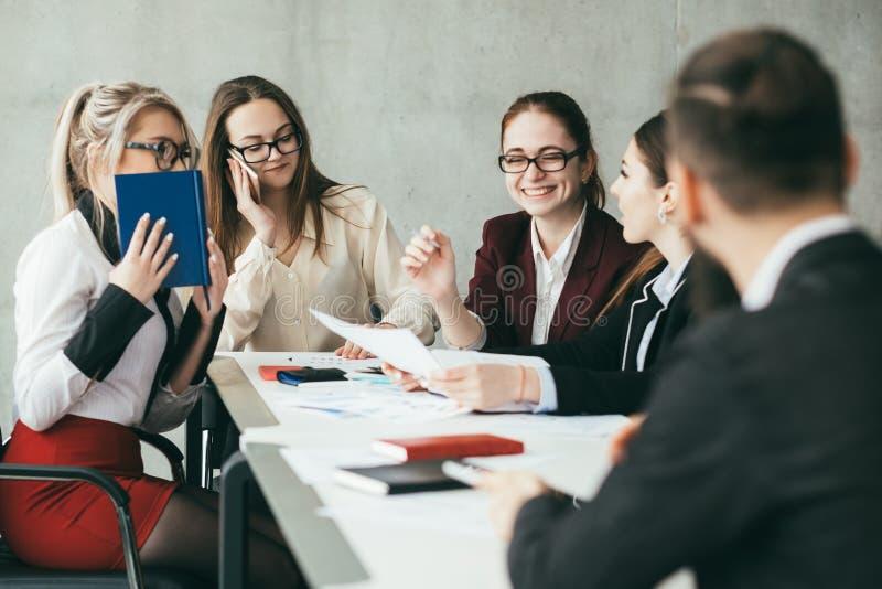 Friendly office successful team discuss statistics stock photo