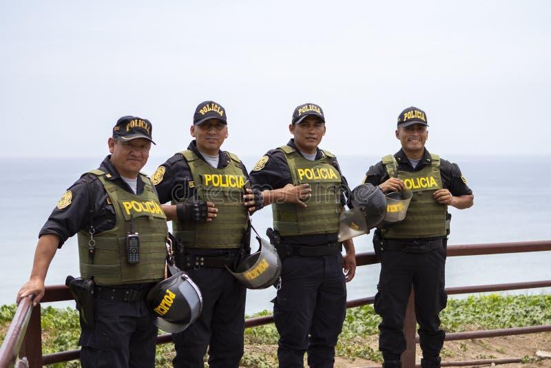 Friendly Peruvian police men smiling in Miraflores royalty free stock photo