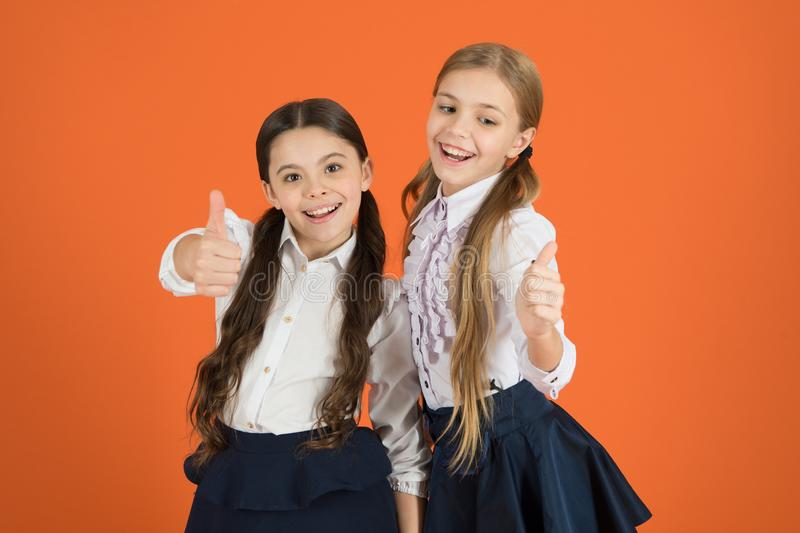 Friendly relations at school. Making friends while studying school. School friendship concept. Cheerful children stock images