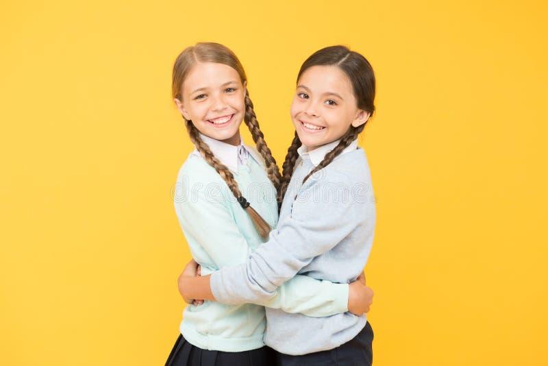 Friendly relationship. Friendship goals. Cute school girls classmates. Cheerful mood concept. My dear friend. First. School day. Sisterhood and friendship stock image