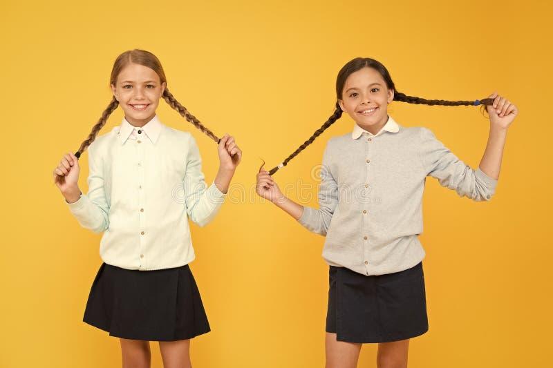 Friendly relationship. Friendship goals. Cute school girls classmates. First school day. Sisterhood and friendship. Cheerful mood concept. School friendship royalty free stock photos