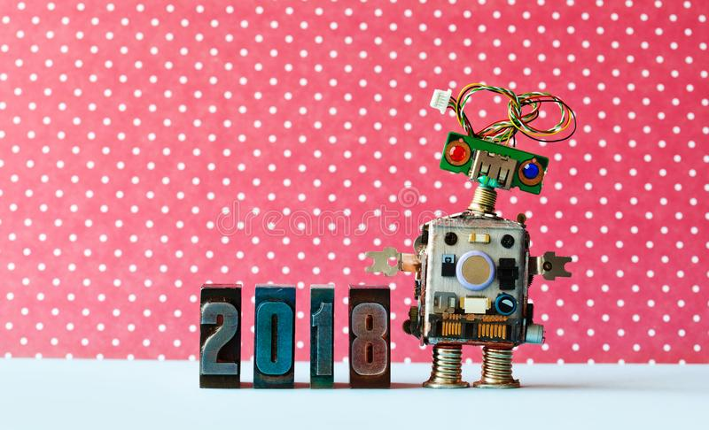 Friendly robot 2018 letterpres digits, red dot background pattern. Creative design new year xmas poster. royalty free stock image