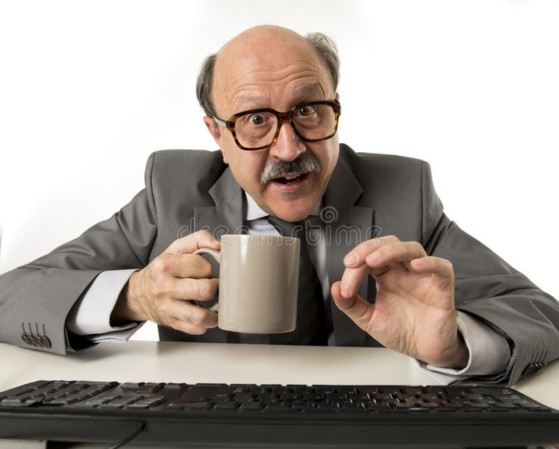 Friendly 60s bald senior business man holding coffee cup drinking happy having breakfast at office computer desk smiling. Portrait of funny and friendly 60s bald stock photos
