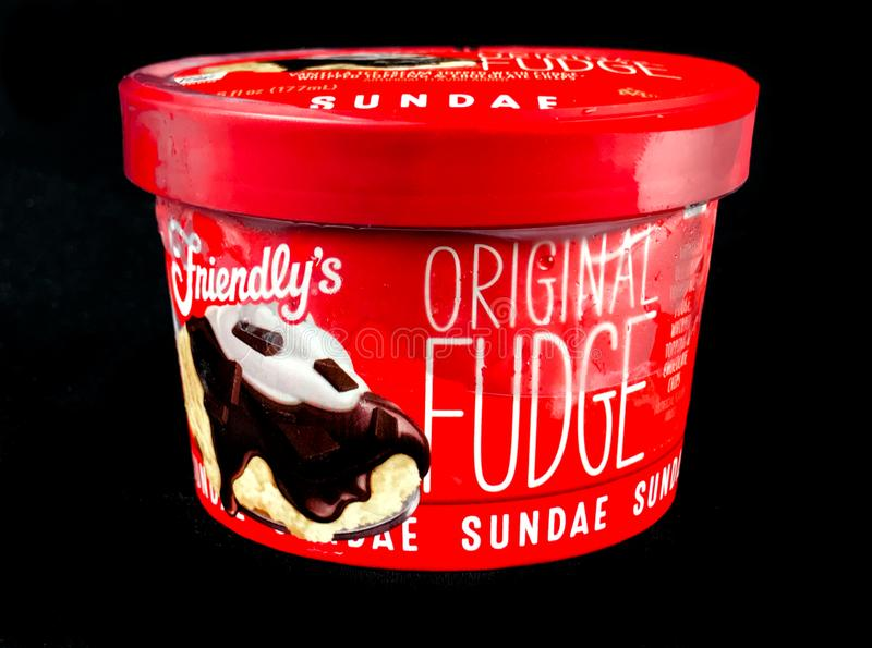 Friendly`s Individual Original Fudge Ice Cream Sundae. Friendly`s Individual Ice Cream Sundae on a black backdrop stock photography