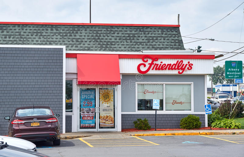 Friendly's restaurant and parking. PLATTSBURGH, USA - AUGUST 23, 2017 : Friendly's restaurant and parking. Friendly's is a restaurant chain on the United States royalty free stock photo