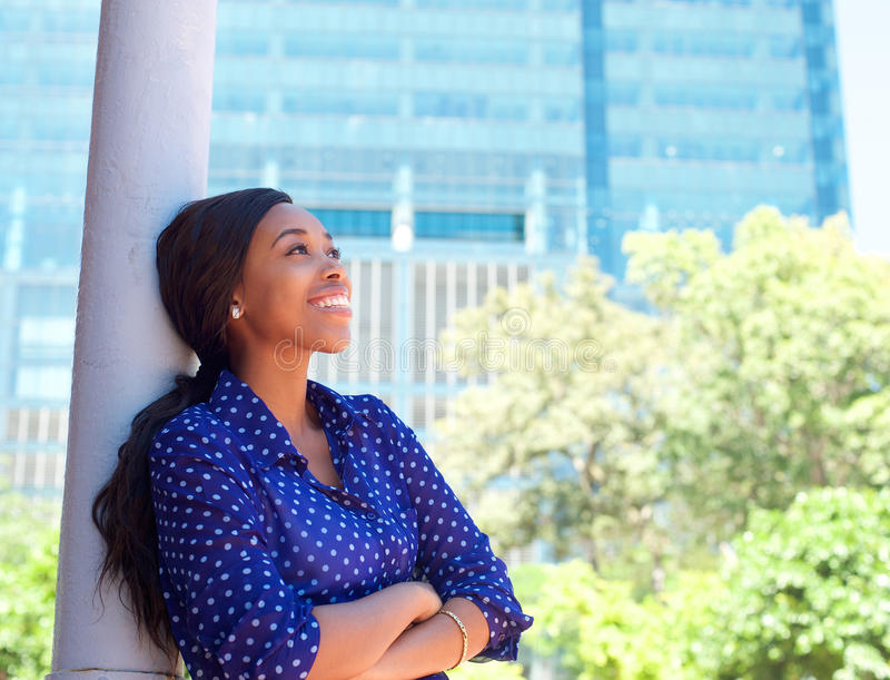 Friendly smiling business woman outside office building stock photography