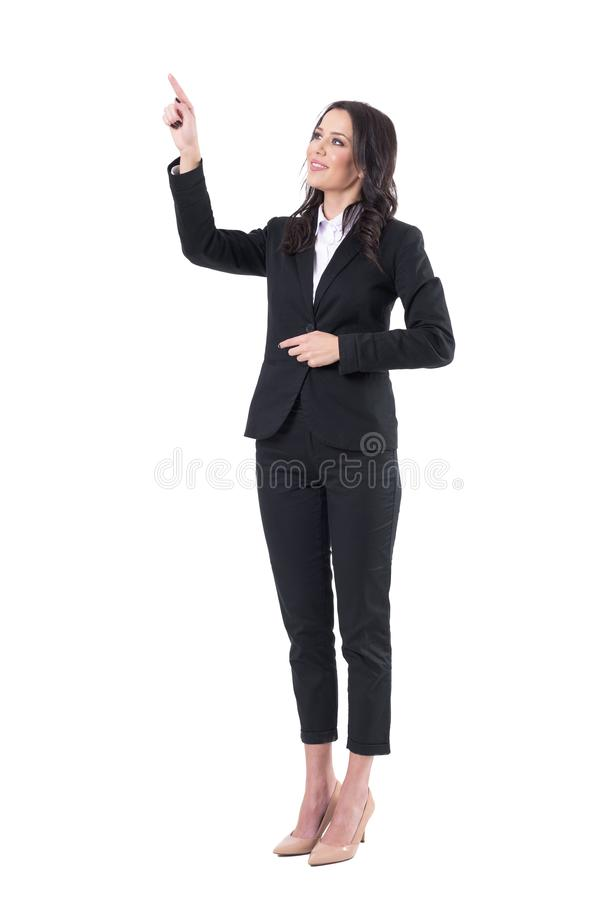 Friendly smiling business woman pointing finger using touch screen on virtual reality. Full body isolated on white background stock photo