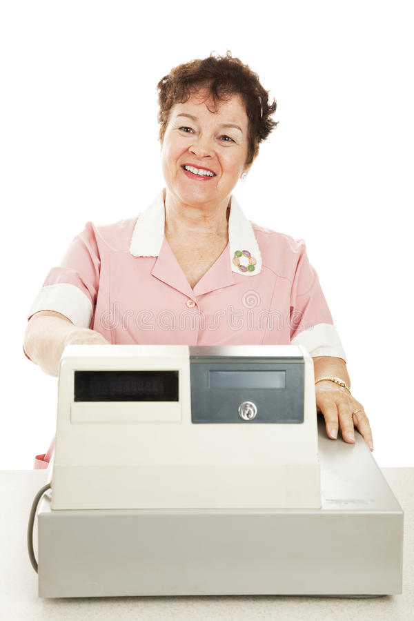 Friendly Smiling Cashier. Behind her cash register. White background stock photo