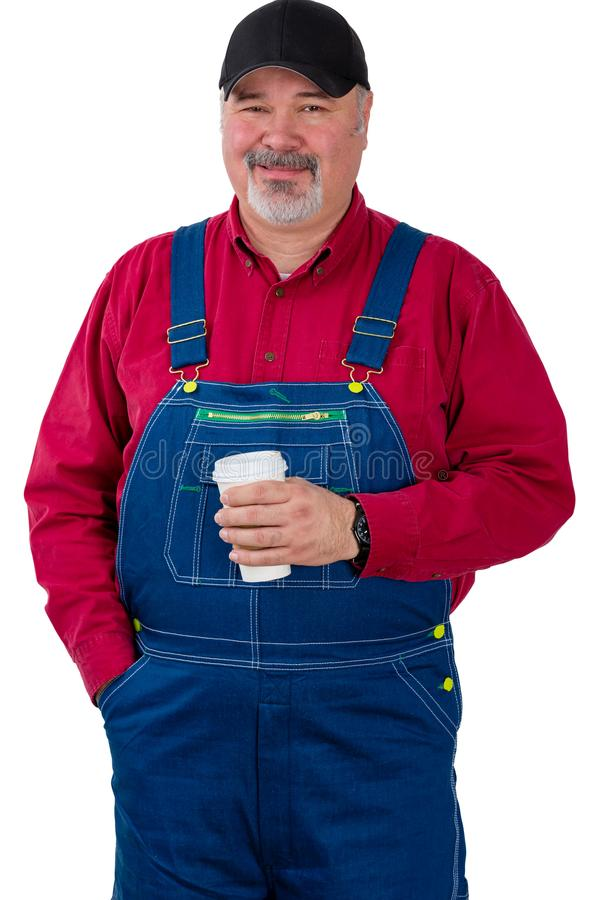 Friendly smiling farm worker holding coffee stock photos