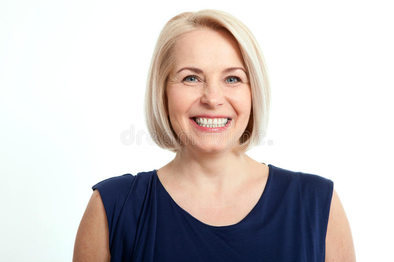 Friendly smiling middle-aged business woman isolated on white background royalty free stock photos