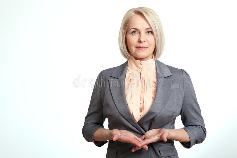 Friendly smiling middle-aged business woman isolated on white background stock images