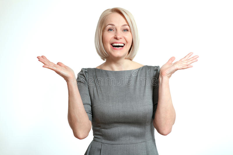Friendly smiling middle-aged business woman isolated on white background. Woman looking surprised royalty free stock images
