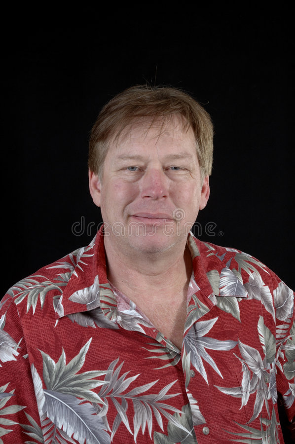 Friendly smiling middle-aged man stock images
