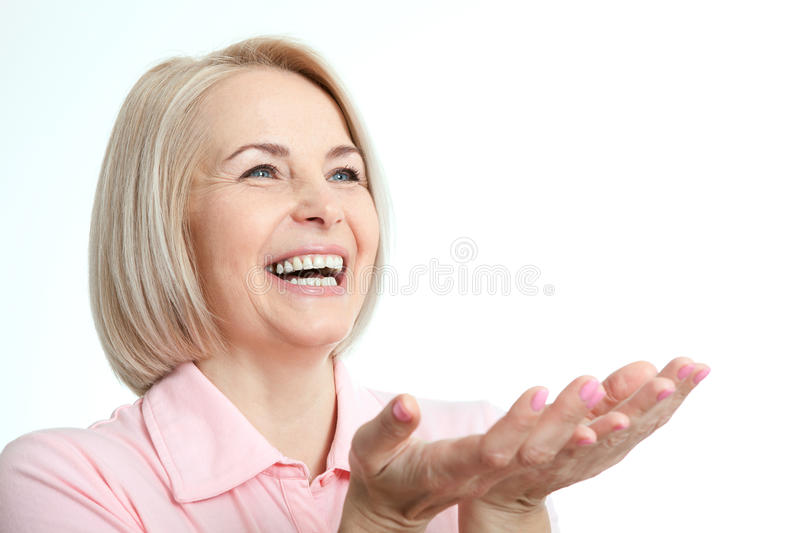 Friendly smiling middle-aged woman isolated on white background royalty free stock photos